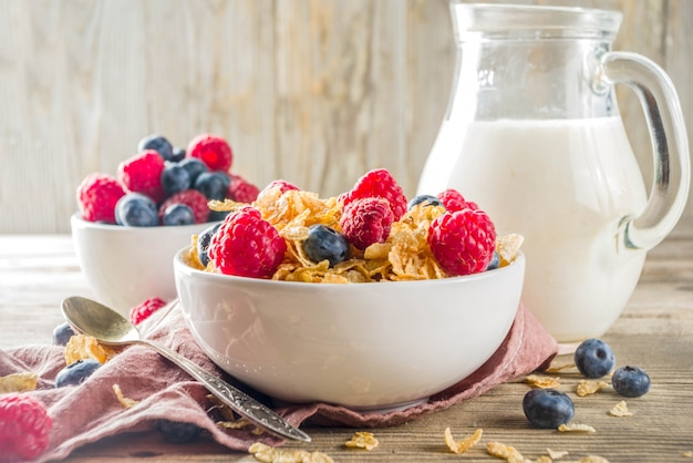 Breakfast corn flakes with milk and berries