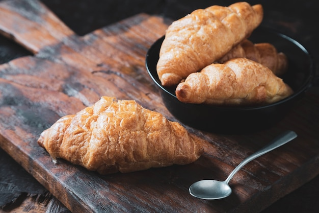 Breakfast croissant bread on the wooden table
