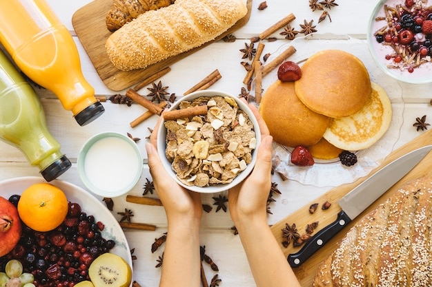 Breakfast decoration with hands holding cereals