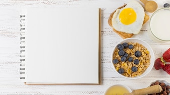 Breakfast dishes next to notebook