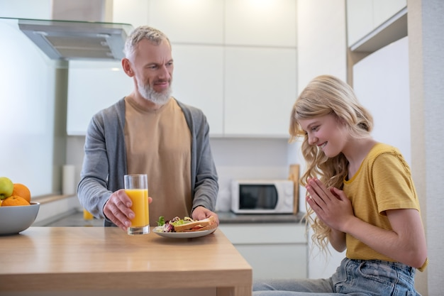 Breakfast. a father and a daughter in the kitchen having breakfast
