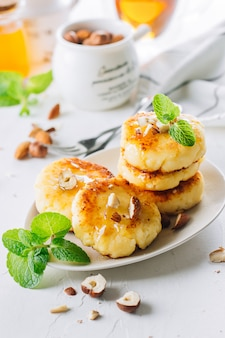 Breakfast food delicious concept. cottage cheese pancakes, syrniki, curd fritters with honey