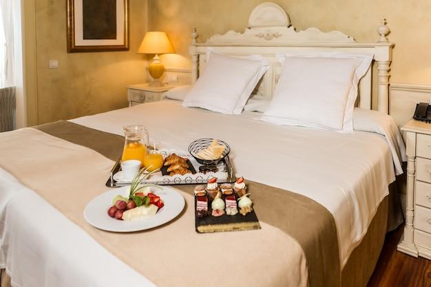 Breakfast food on hotel bed
