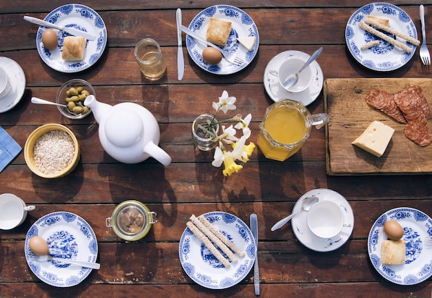 Breakfast fresh country food on wooden brown table in the garden, top view