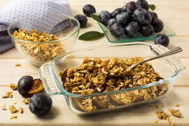 Breakfast fresh plum granola in the glass baking tray