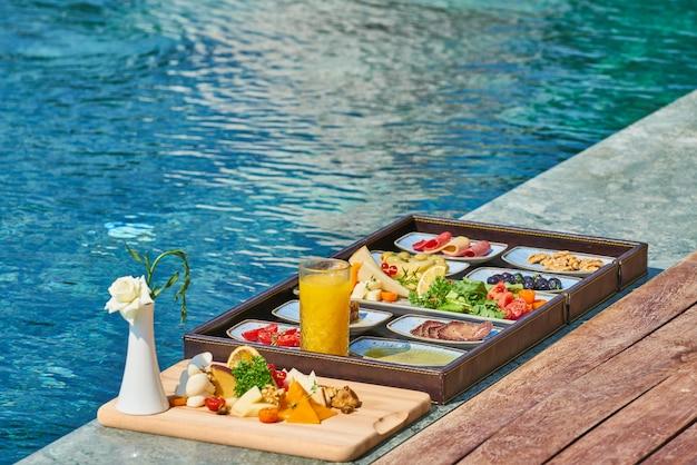 Breakfast in luxury hotel pool