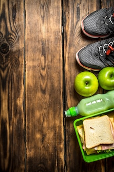 Breakfast in the morning sandwiches , fruit ,milkshake and sports sneakers