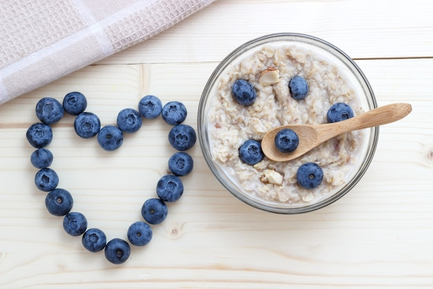 Breakfast of oatmeal with blueberries as a symbol of the heart