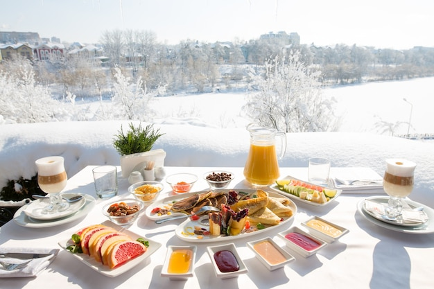 Breakfast at the restaurant in the snowy winter outdoors.