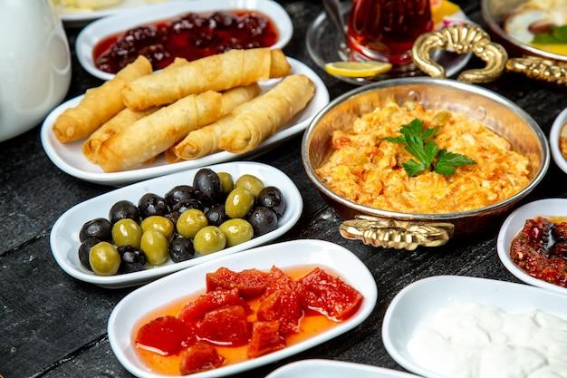 Breakfast set  olives  tomato  eggs  side view