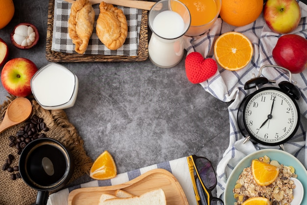 Breakfast table with copy space on cement texture background, view from above.