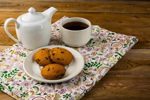 Breakfast tea on wooden background