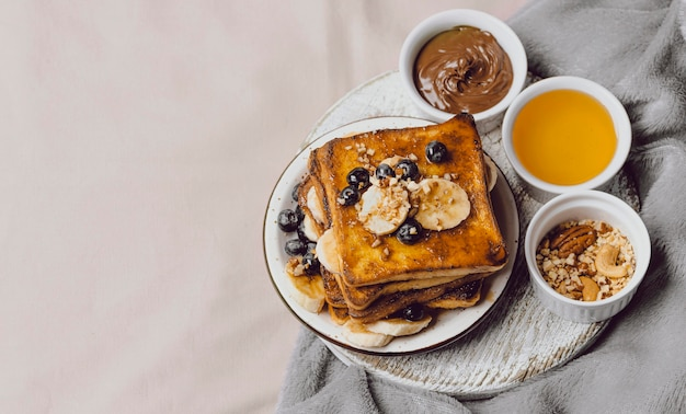 Breakfast toast in bed with blueberries and copy space