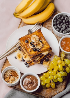 Breakfast toast with blueberries and chocolate sauce