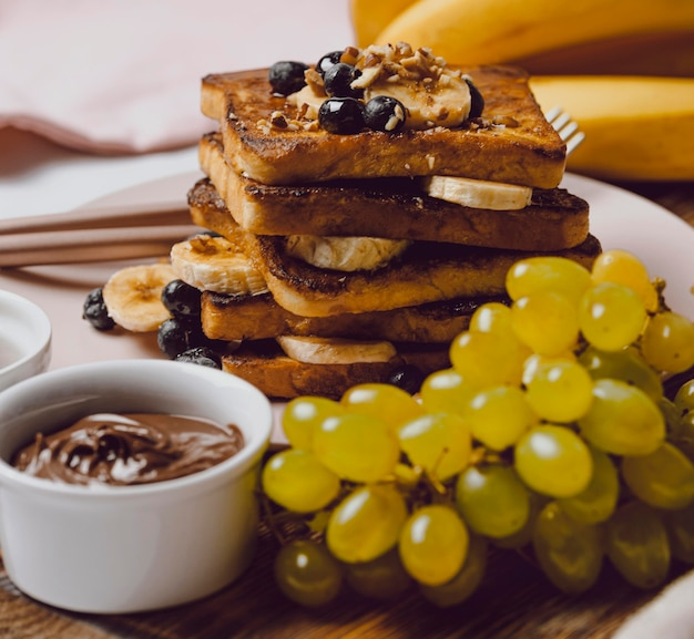 Breakfast toast with blueberries and grapes