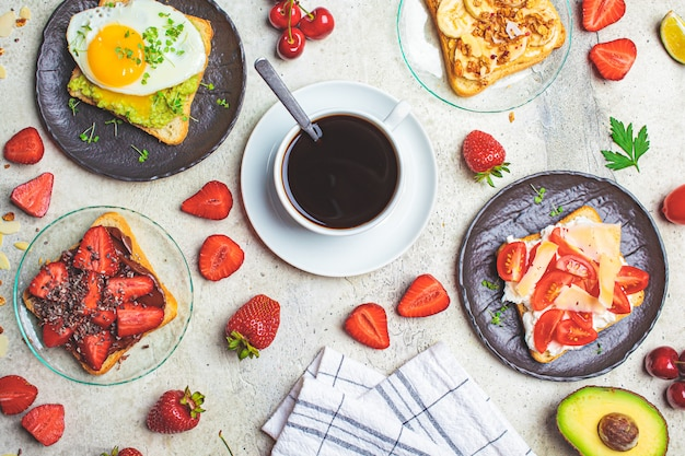Breakfast toasts with coffee on table, top view.