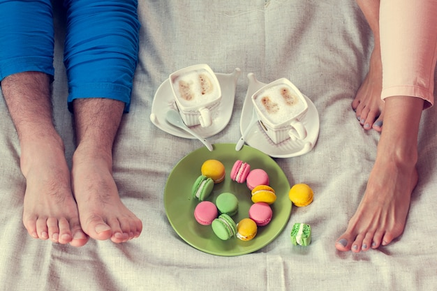 Breakfast together in bed with macaroons