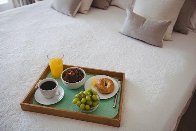 Breakfast tray on bed in bedroom
