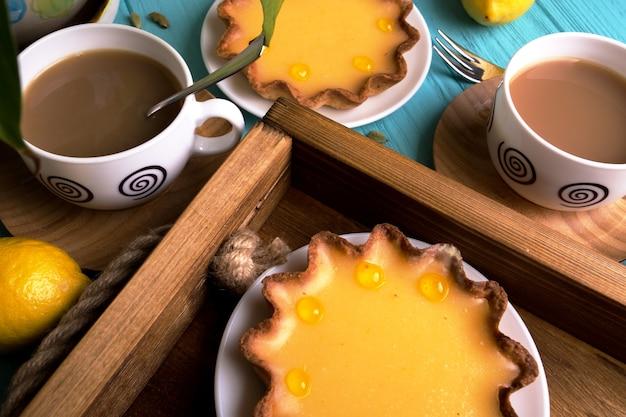 Breakfast - a tray of lemon tarts and coffee