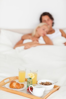 Breakfast on a tray with a couple sleeping