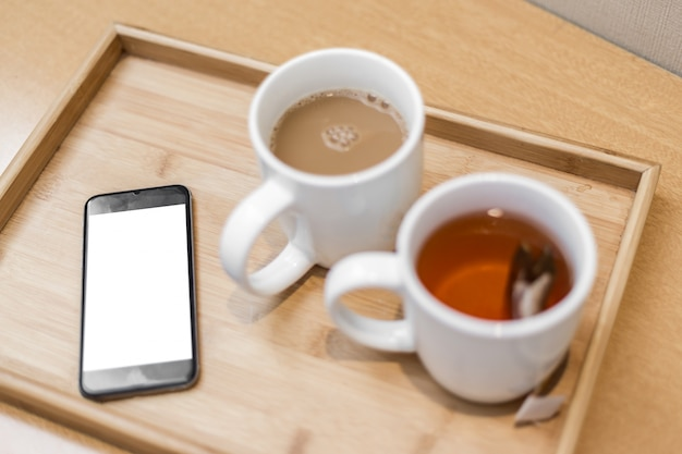Breakfast tray with a smartphone