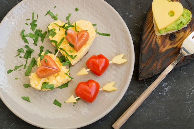 For breakfast on valentine's day can be omlette with bread in the shape of a heart.