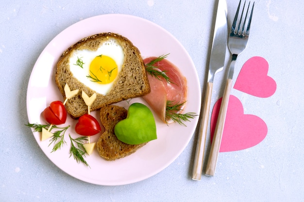 Breakfast for valentine's day. egg and toast in the shape of a heart.