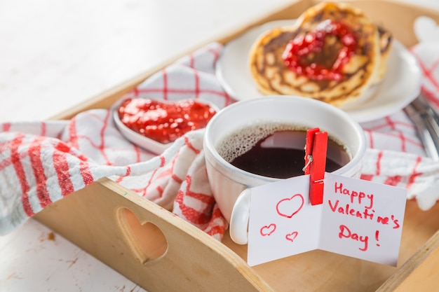 Breakfast for valentines day - pancaked, jam and coffee