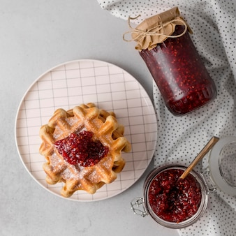 Breakfast waffles and raspberry jam flat lay