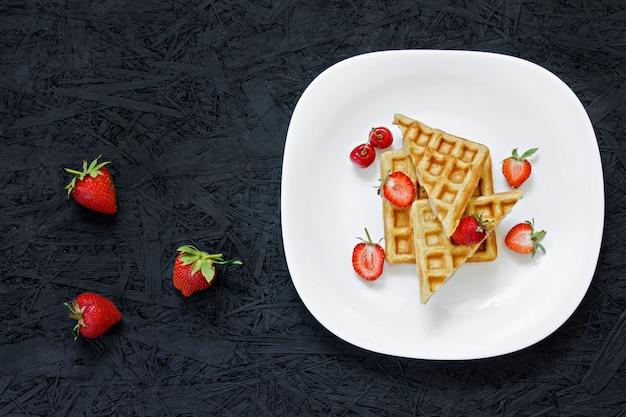 Breakfast. waffles with strawberries, cherries, summer berries.
