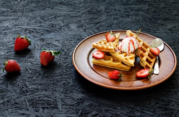 Breakfast. waffles with strawberries, cherries, summer berries