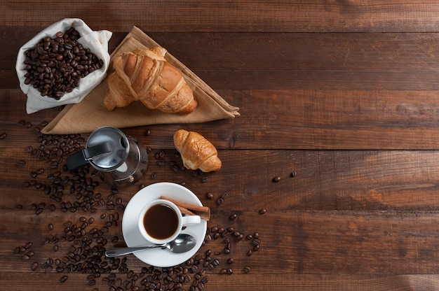 Breakfast with aromatic black coffee and croissant, good morning, great start to the day. coffee break, copy space,y