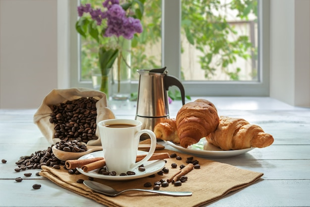 Breakfast with aromatic black coffee and croissant, good morning, great start to the day. coffee break, copy space
