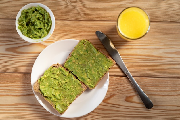 Breakfast with avocado toast, orange juice