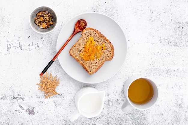Breakfast with bread and cup of tea