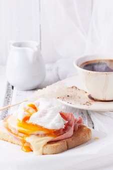 Breakfast with coffee and toast with cheese and egg