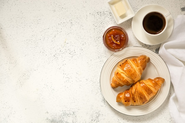 Breakfast with croissants on concrete.