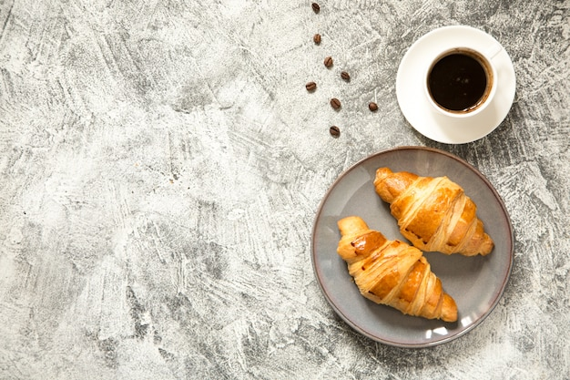 Breakfast with croissants on concrete