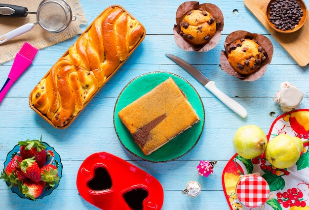 Breakfast with different pastries and fruits on a wooden
