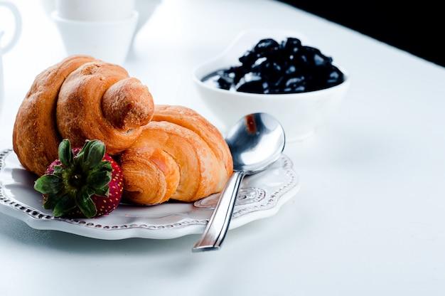 Breakfast with eggs, fresh croissants,