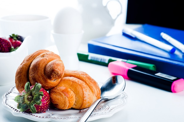 Breakfast with eggs, fresh croissants