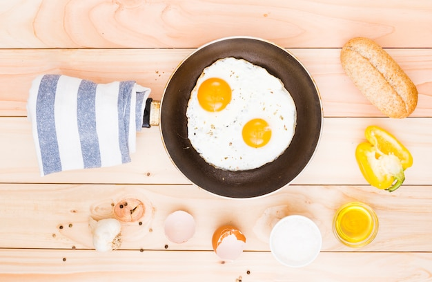 Breakfast with eggs and frying pan