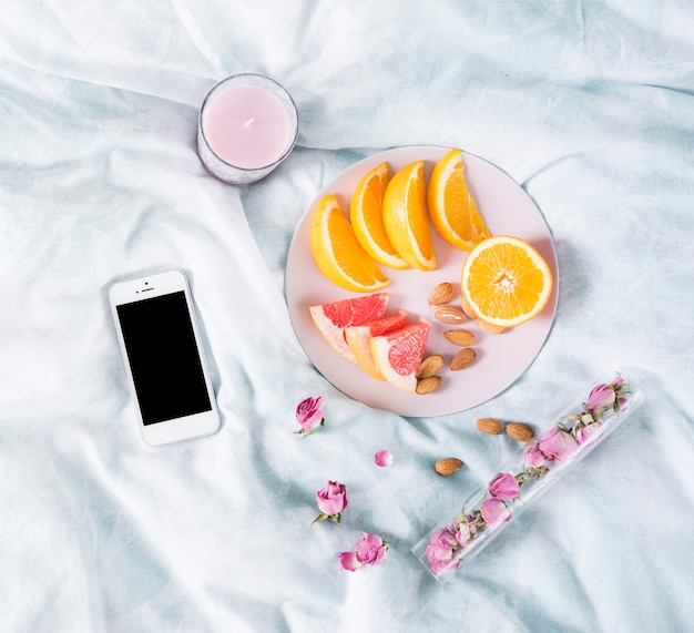 Breakfast with fruits and mobile