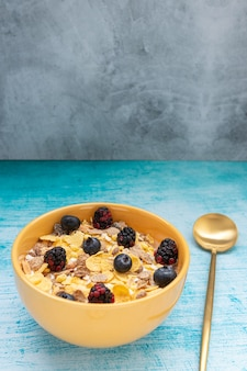 Breakfast with granola cereal and fruits, such as blueberry and blackberries
