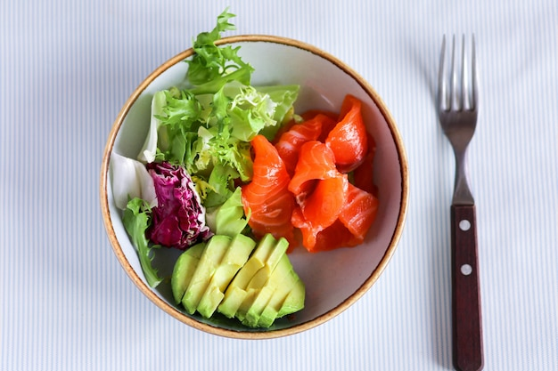 Breakfast with lettuce and avocado. healthy breakfast with red fish and avocado.