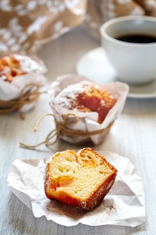 Breakfast with muffins and coffee close up