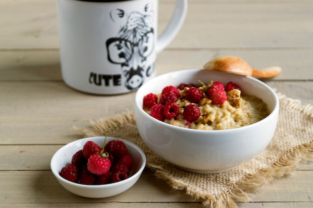 Breakfast with oatmeal and fresh raspberries.