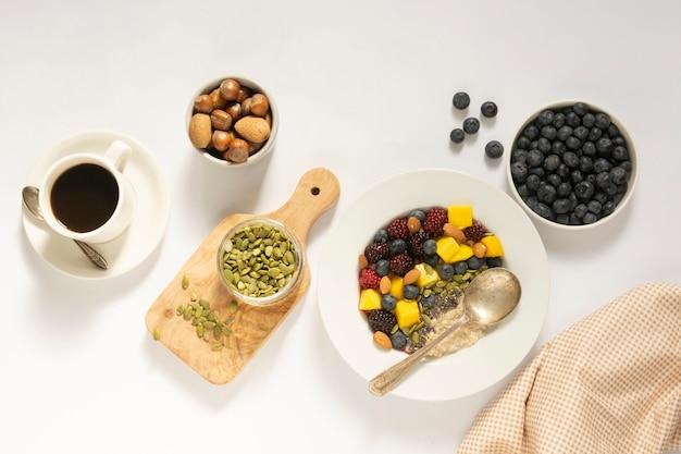 Breakfast with oatmeal porridge and fruits