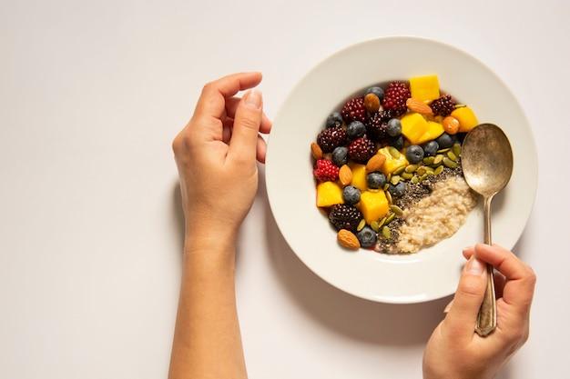 Breakfast with oatmeal porridge with fruits