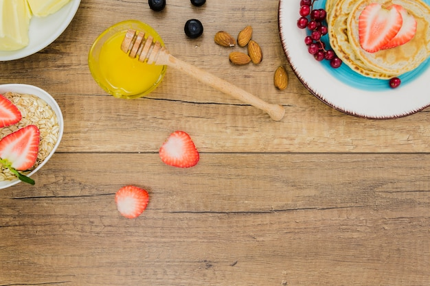 Breakfast with pancakes and strawberries